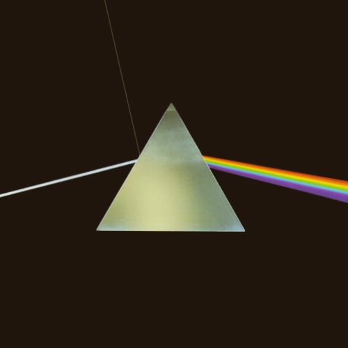 "White light splitting into different colors. You can see the entering beam of white light, a small beam of reflected white light and a colorful beam of light exiting the side of the prism. Album cover of Pink Floyd's ""The Dark Side of the Moon""."